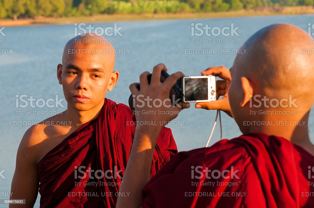 Burmese monks taking a picture stock photo