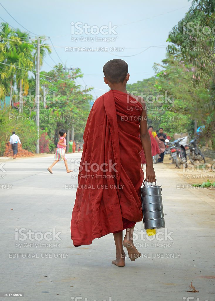 Burmese monks walking morning alms stock photo