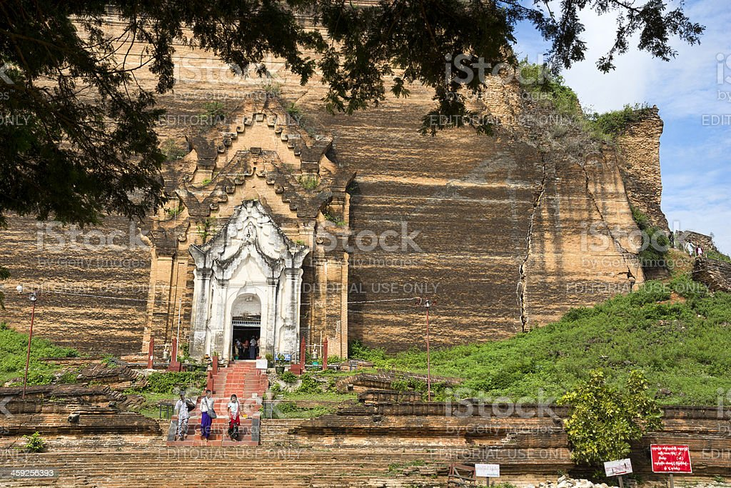Burmese people leaving the famous Mingun pagoda royalty-free stock photo