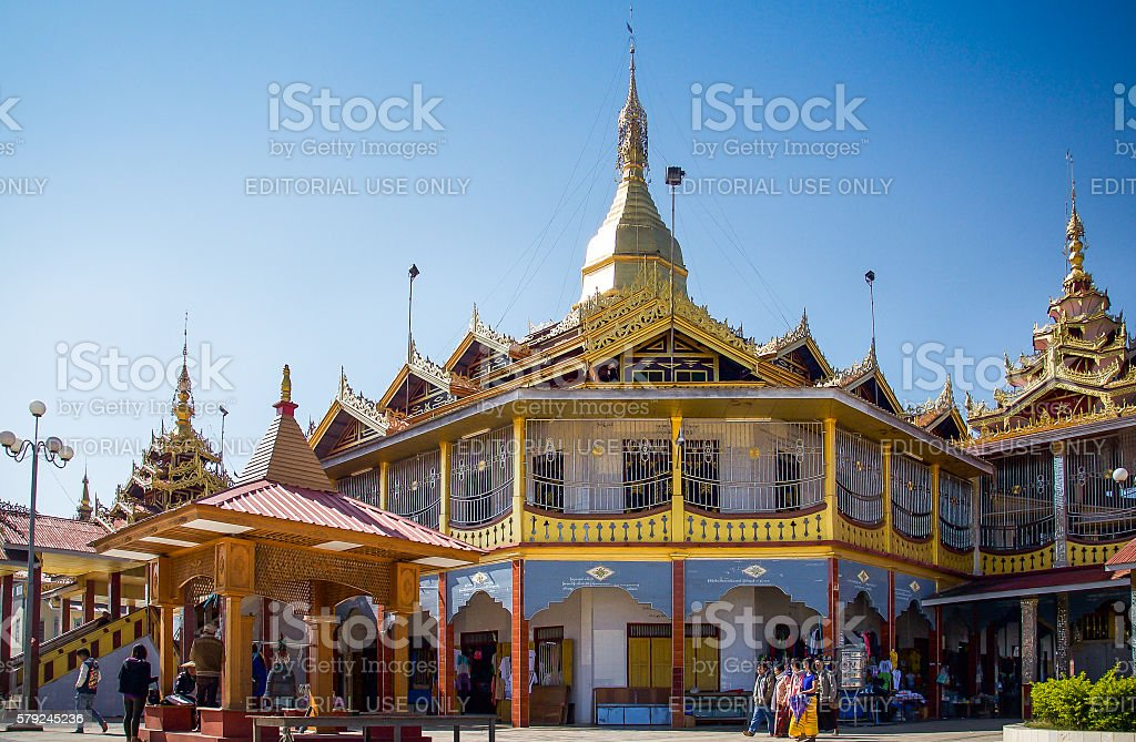 Burmese people visit a temple by Inle lake stock photo