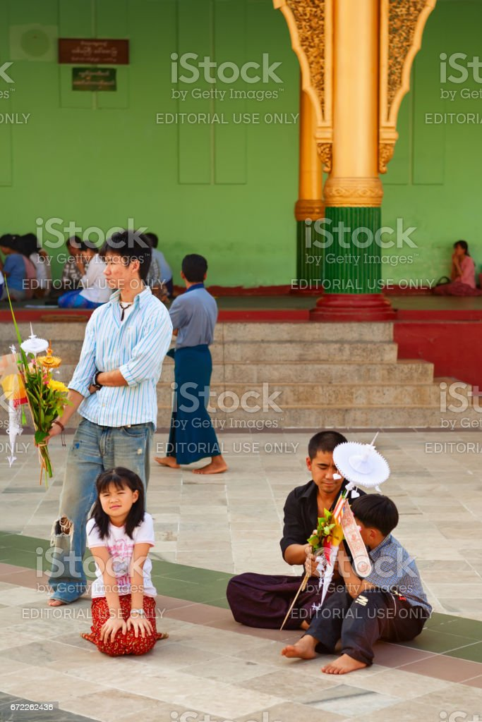 Burmese people with ritual offering at Shwedagon pagoda square stock photo