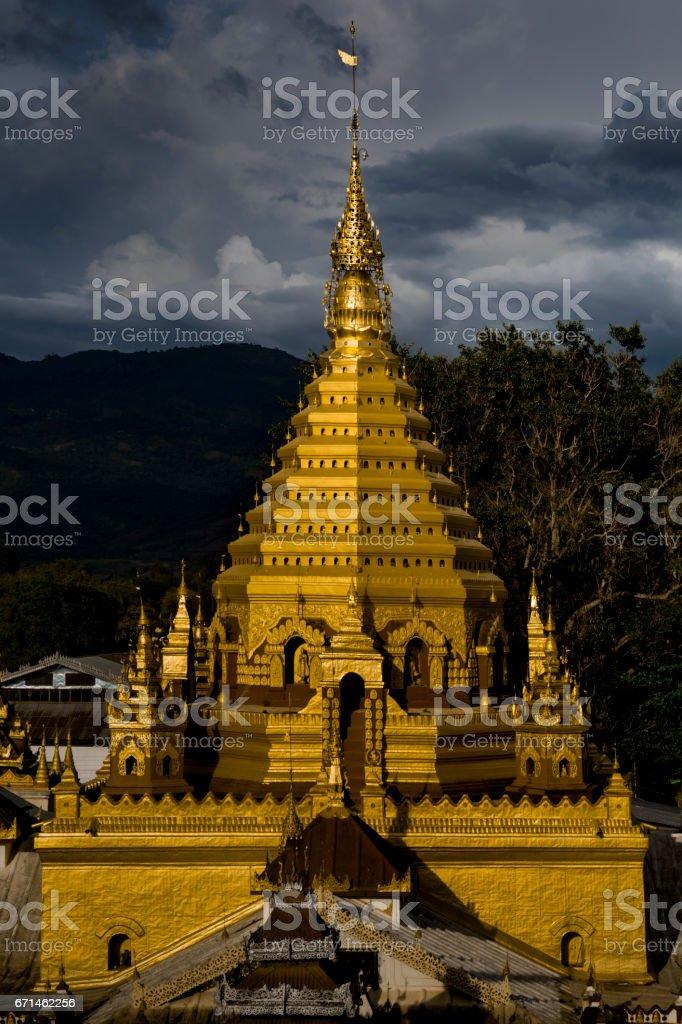 Burmese stupa at sunset, Yadana Man Aung Phaya Pagoda, Nyaungshwe, Inle Lake, Myanmar stock photo