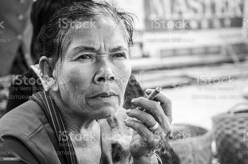 Burmese woman in Kalaw smoking cheroot stock photo