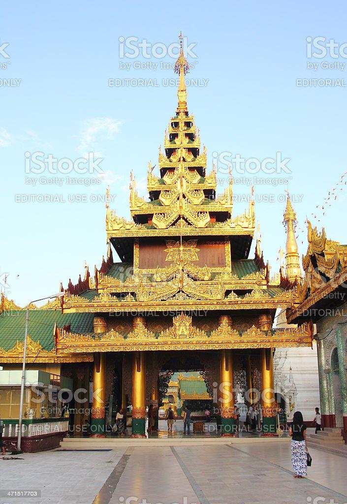 Burmese Woman looking at golden temple in Shwedagon pagoda_Yango royalty-free stock photo