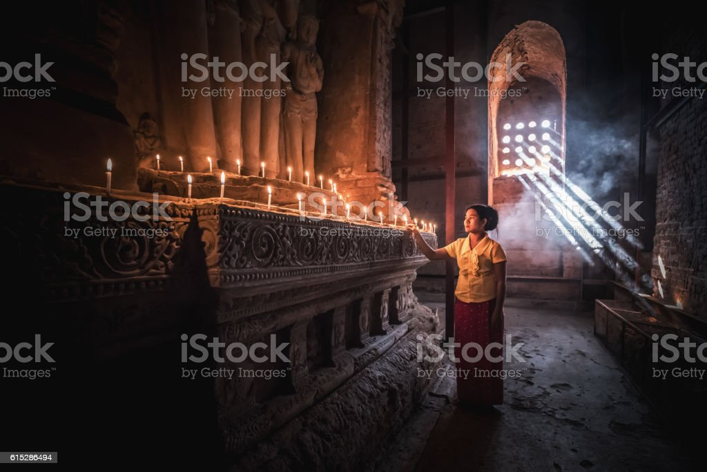 Burmese Woman Praying to Buddha Temple Pagoda Bagan Myanmar stock photo