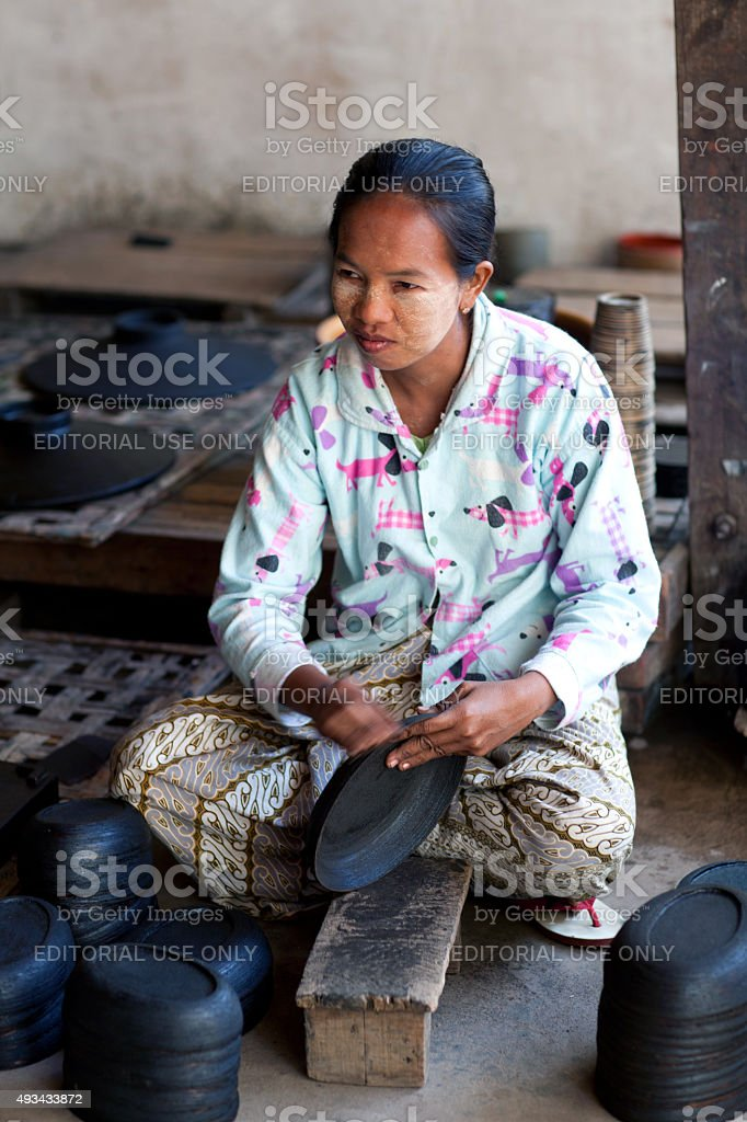 Burmese woman working in a factory of lacquer stock photo