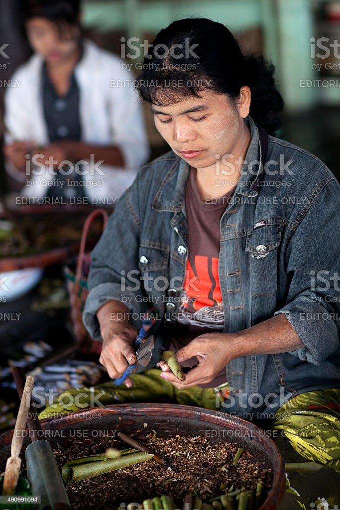Burmese woman working in a tobacco factory, Myanmar stock photo