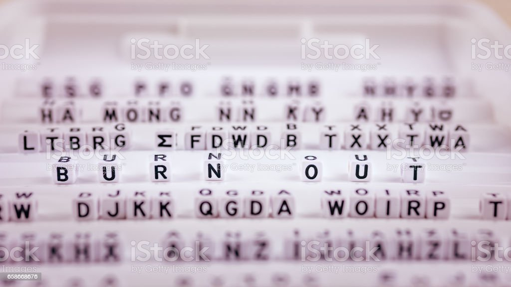 Burn out letters in focus between other blurred lettters stock photo