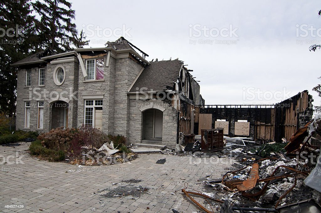 Burned and abandoned Luxury stone home. stock photo