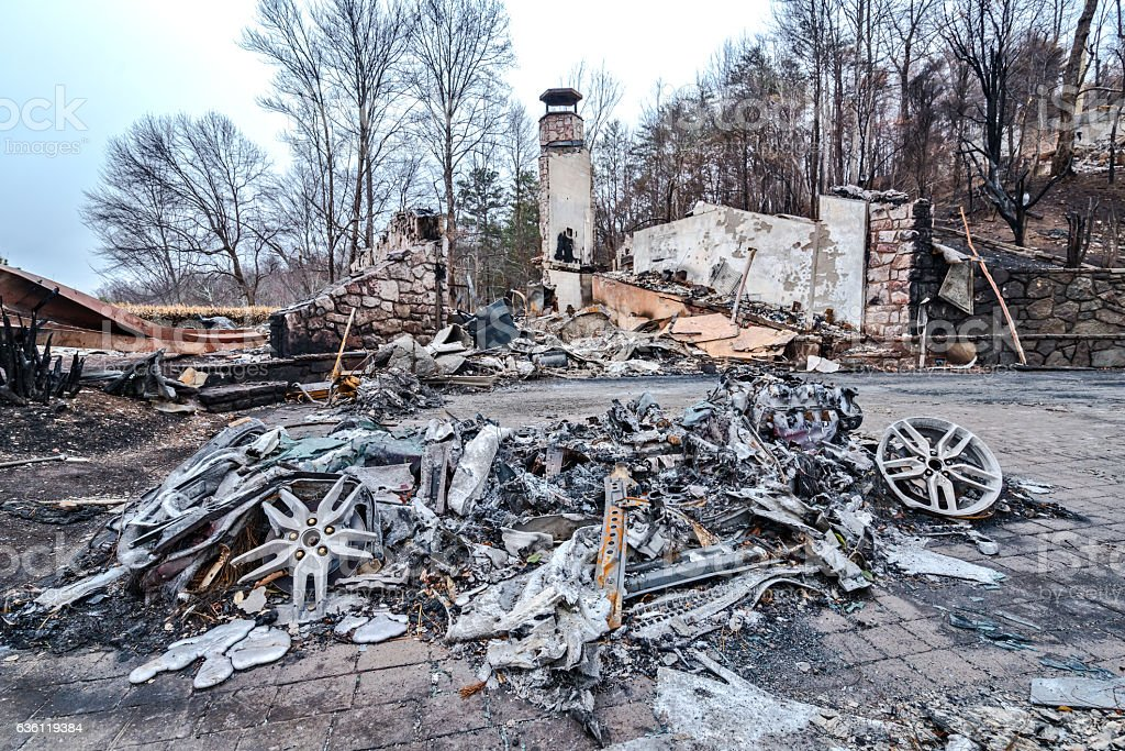 Burned auto and home after forest fires stock photo