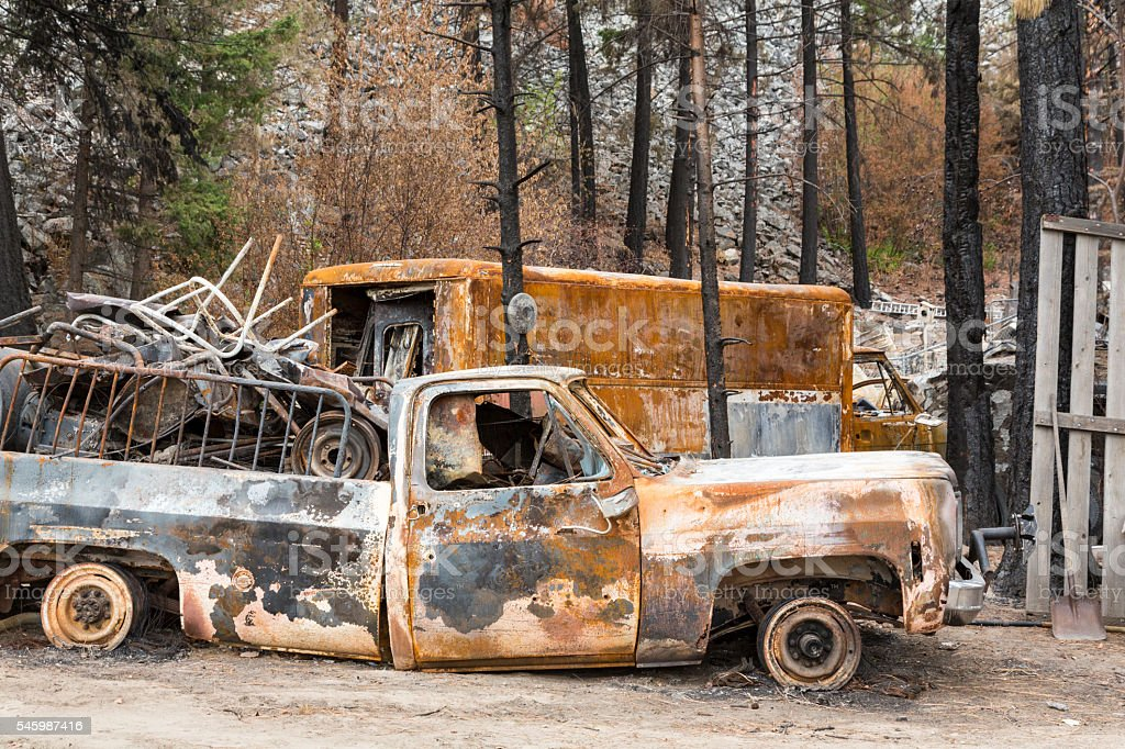 Burned automobiles destroyed by natural disaster fire wildfire stock photo