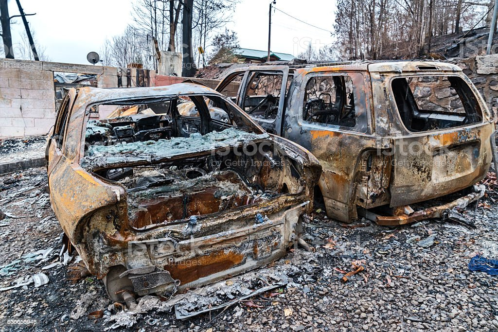 Burned cars and home after forest fires stock photo