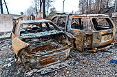 Burned cars and home after forest fires