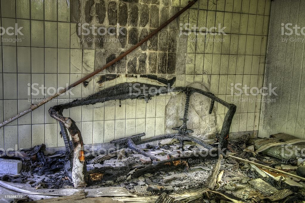 Burned couch stock photo