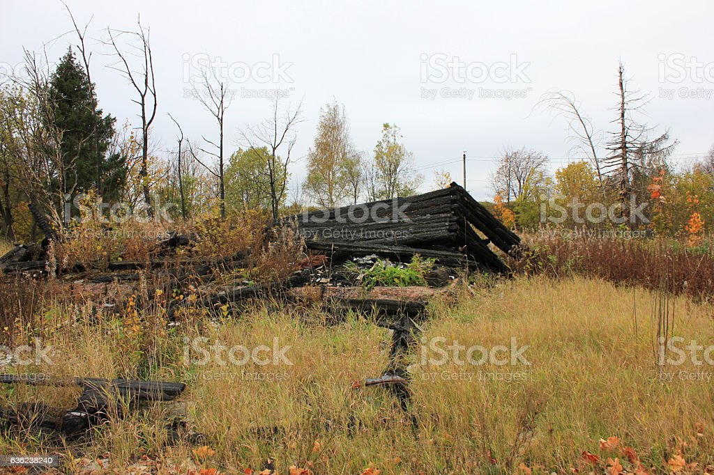 Burned down old house foundation ruins at the countryside stock photo