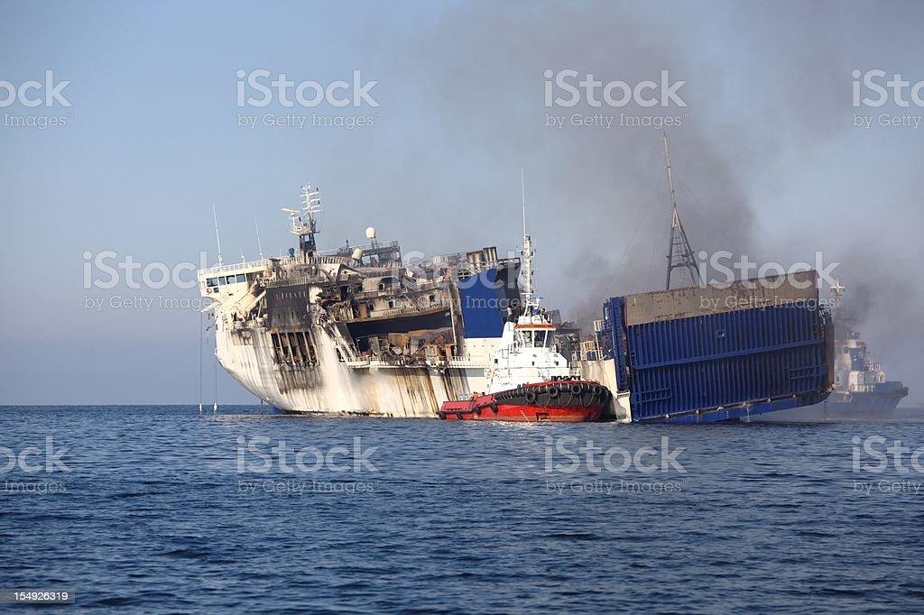 Burned ferry stock photo