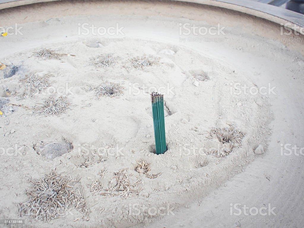 Burned Japanese Green incense joss sticks in censer stock photo