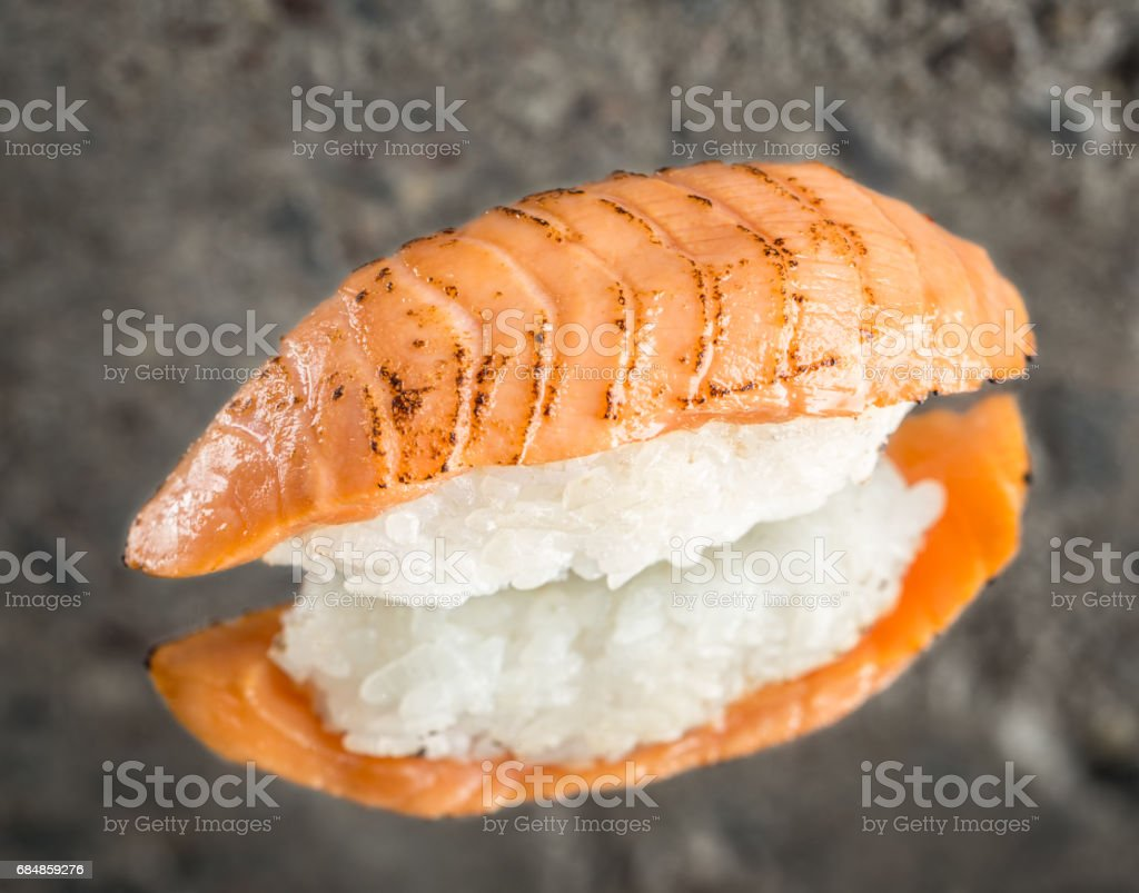 Burned nigiri sushi with salmon stock photo