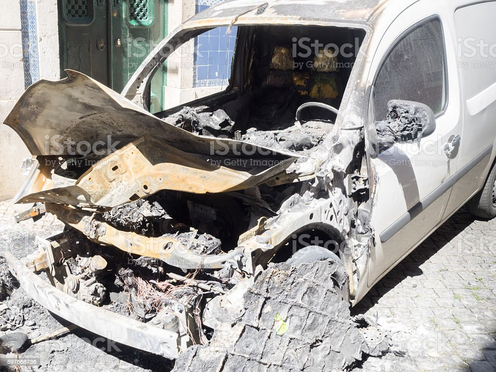 burned out car after explosion stock photo