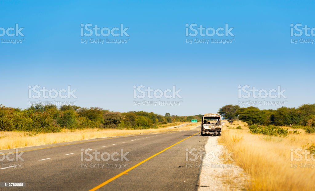 Burned Out Car in Africa stock photo