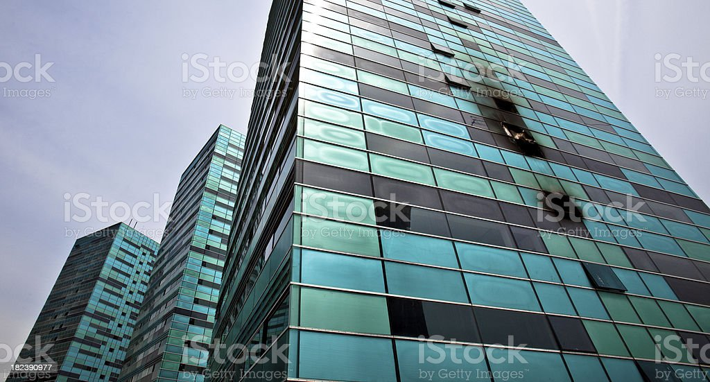 Burned out windows in a skyscraper royalty-free stock photo