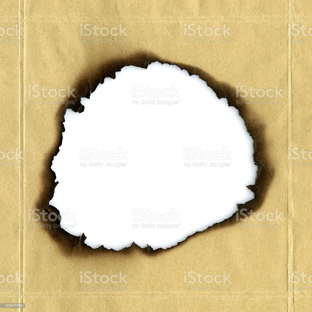Burned paper hole textured background royalty-free stock photo