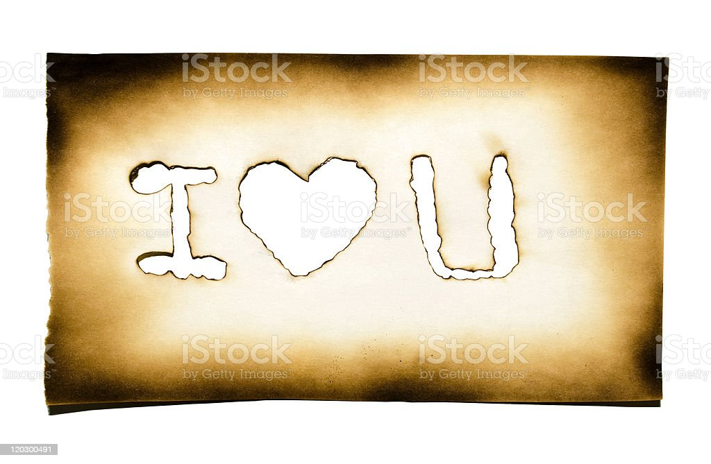 Burned paper with heart and 'i love you' text royalty-free stock photo