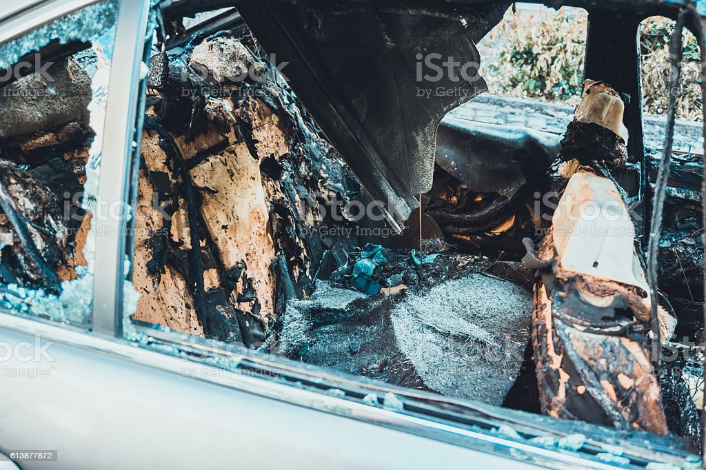 burned seats at a full destroyed car stock photo