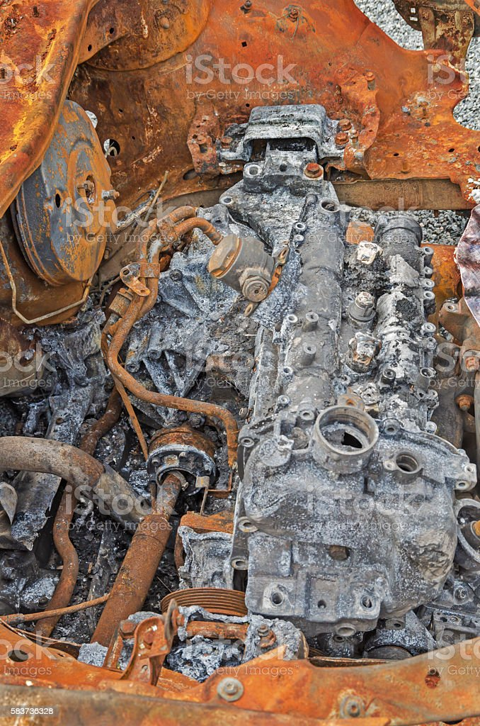 Burned-out car engine stock photo