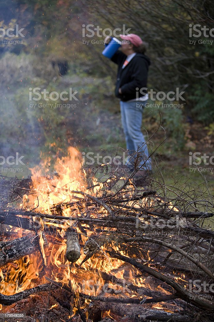 Burning a Cleanup Fire Makes one Thirsty royalty-free stock photo