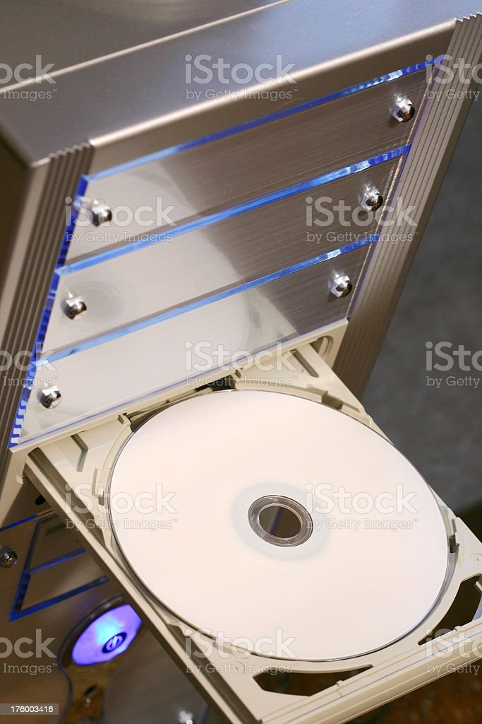 Burning a DVD royalty-free stock photo
