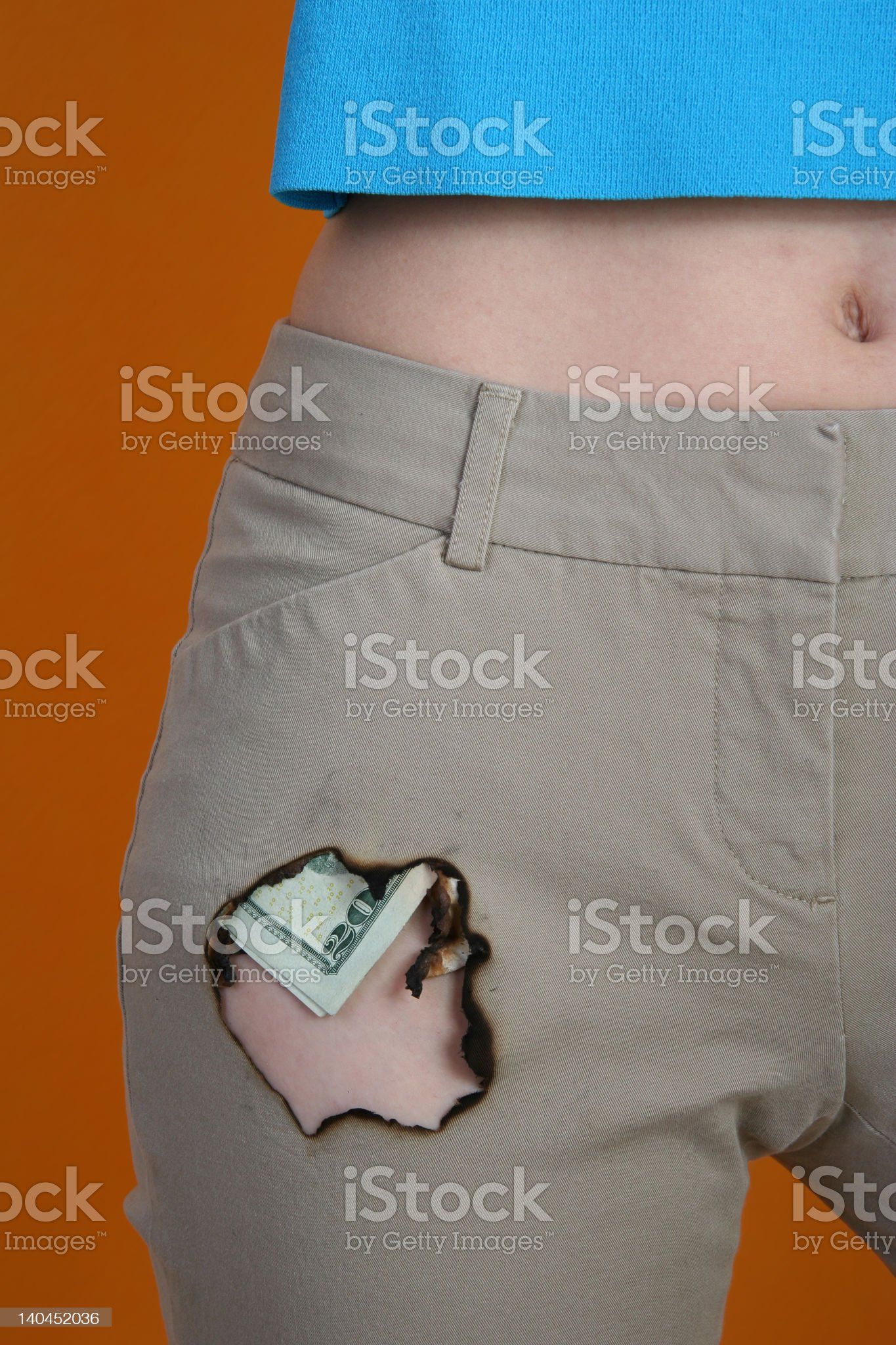 Burning a Hole in Your Pocket royalty-free stock photo