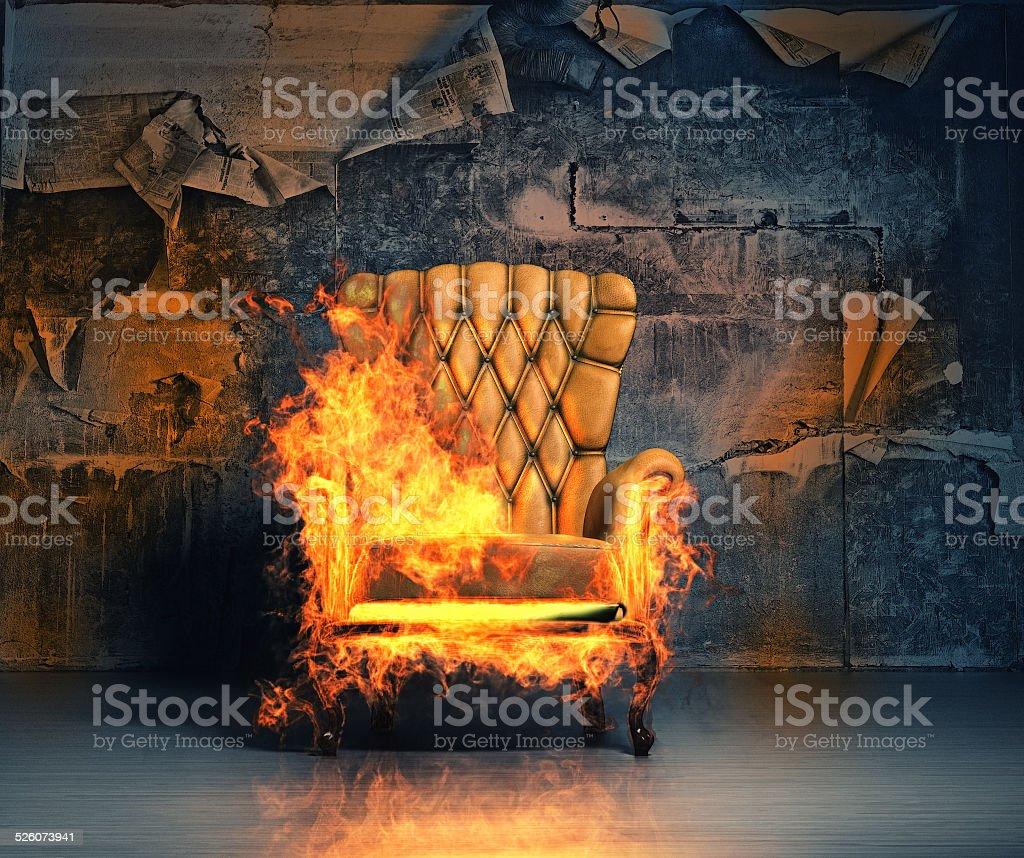 burning armchair stock photo