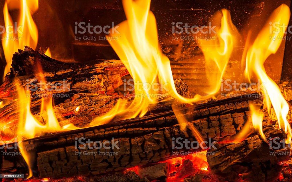 Burning billets in hot stove stock photo