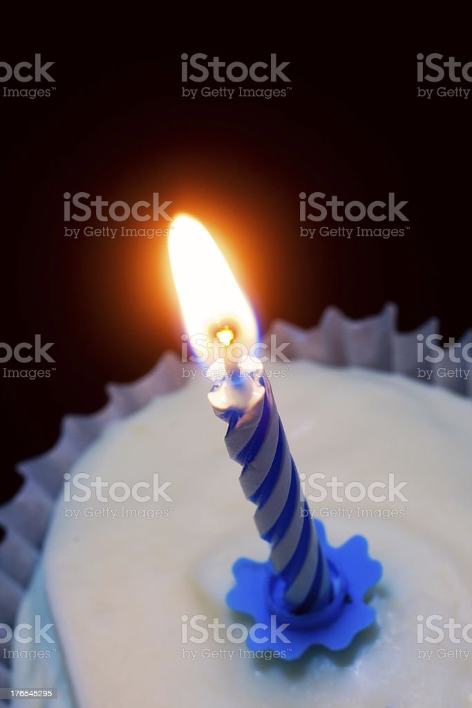 Burning Birthday Candle in Cupcake royalty-free stock photo