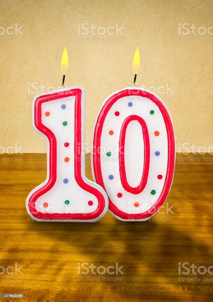 Burning birthday candles number 10 stock photo
