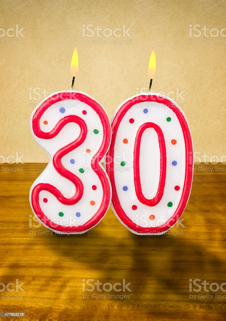 Burning birthday candles number 30 stock photo