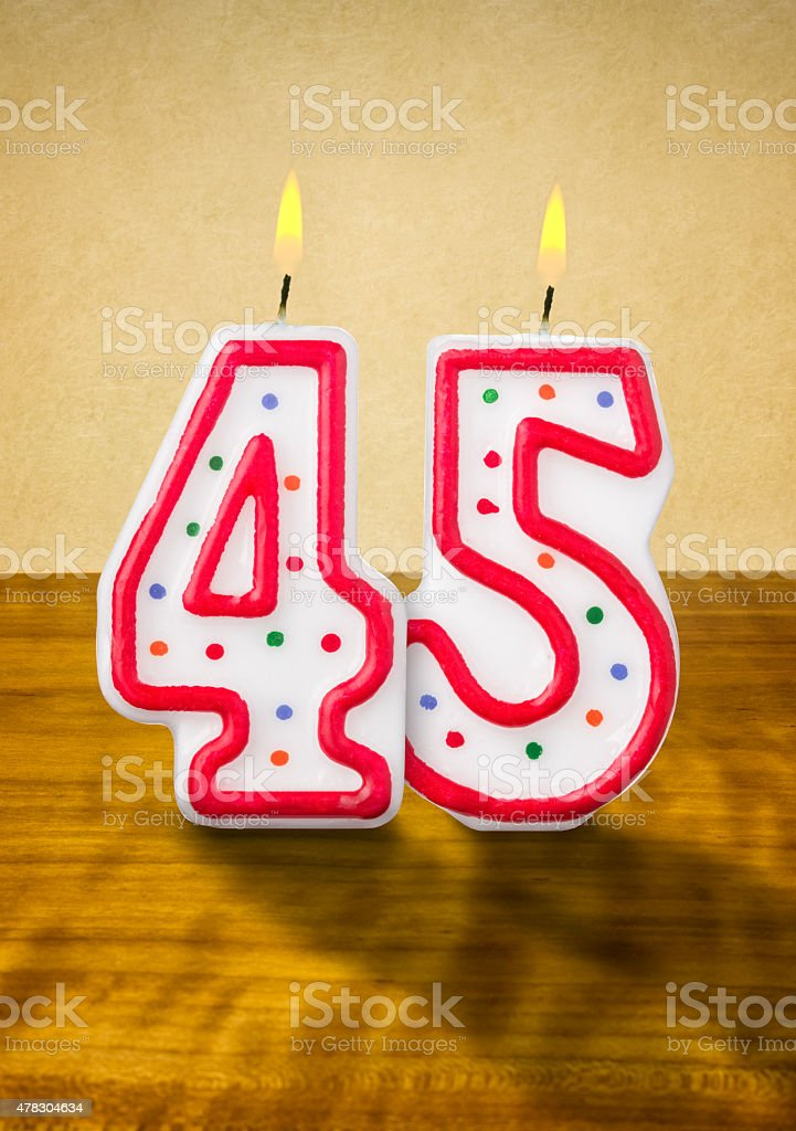 Burning birthday candles number 45 stock photo