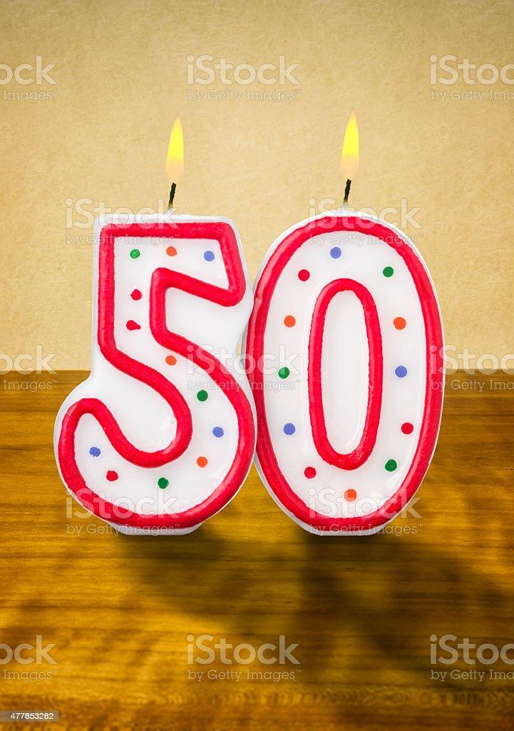 Burning birthday candles number 50 stock photo