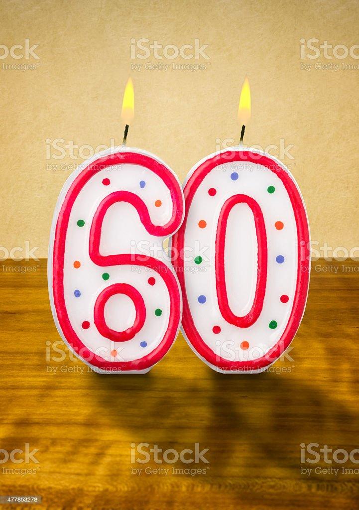 Burning birthday candles number 60 stock photo