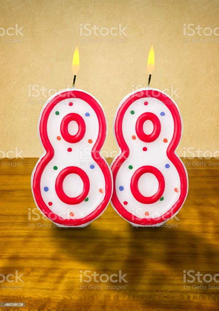 Burning birthday candles number 88 stock photo