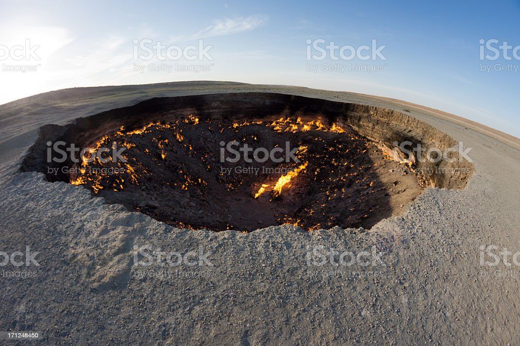 Burning black surface of Darbaza Gas Crater in Turkmenistan stock photo