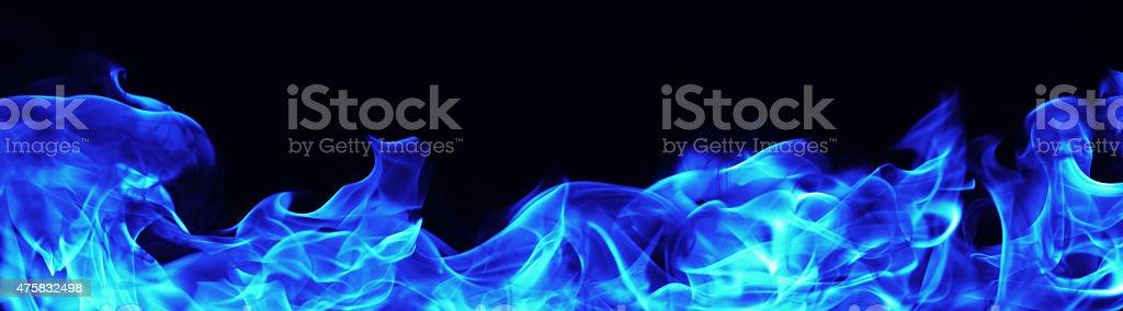 burning blue  fire flame on black background stock photo
