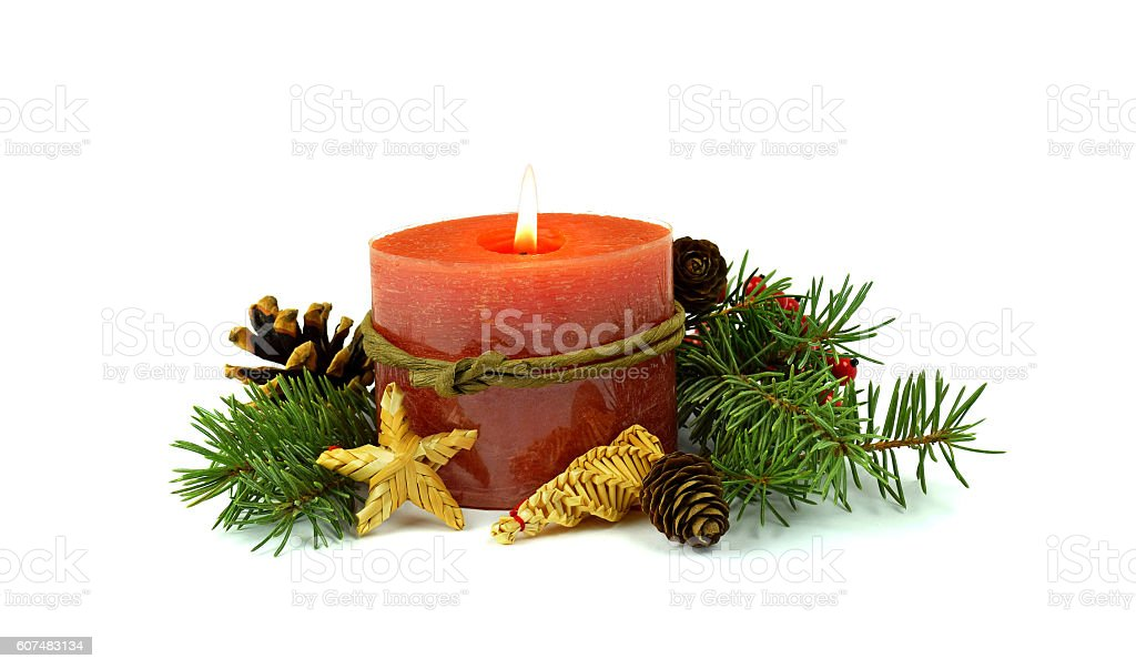 burning candle, fir , cones, straw toys, decorative red berries. / Isolation / stock photo