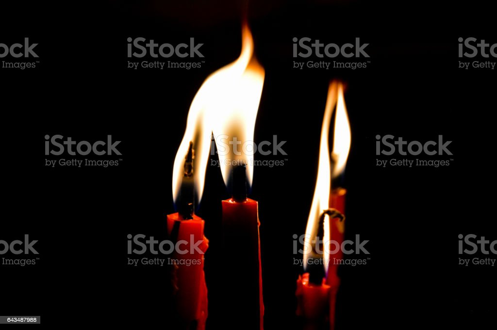 Burning candle in the dark stock photo