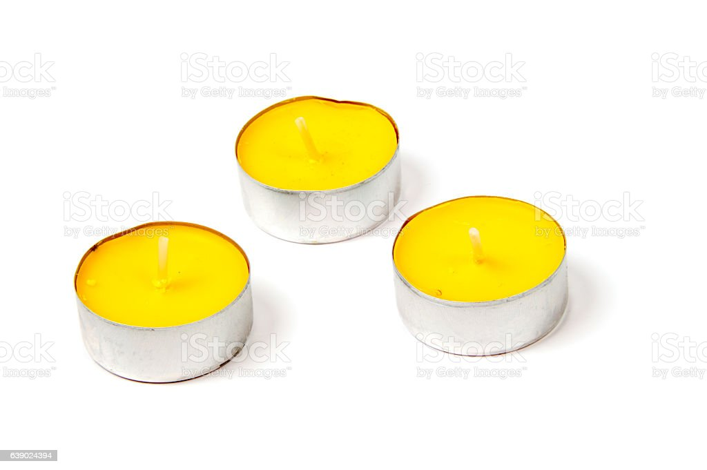 burning candle isolated on white background with light stock photo
