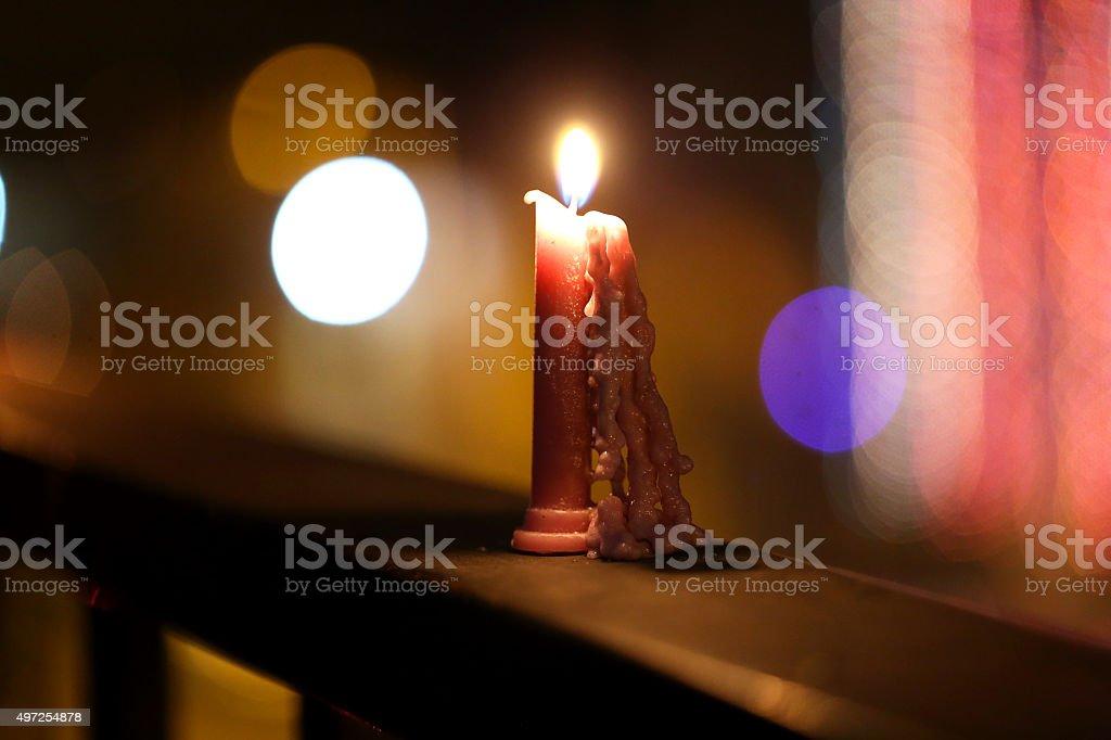 Burning candle on balcony stock photo