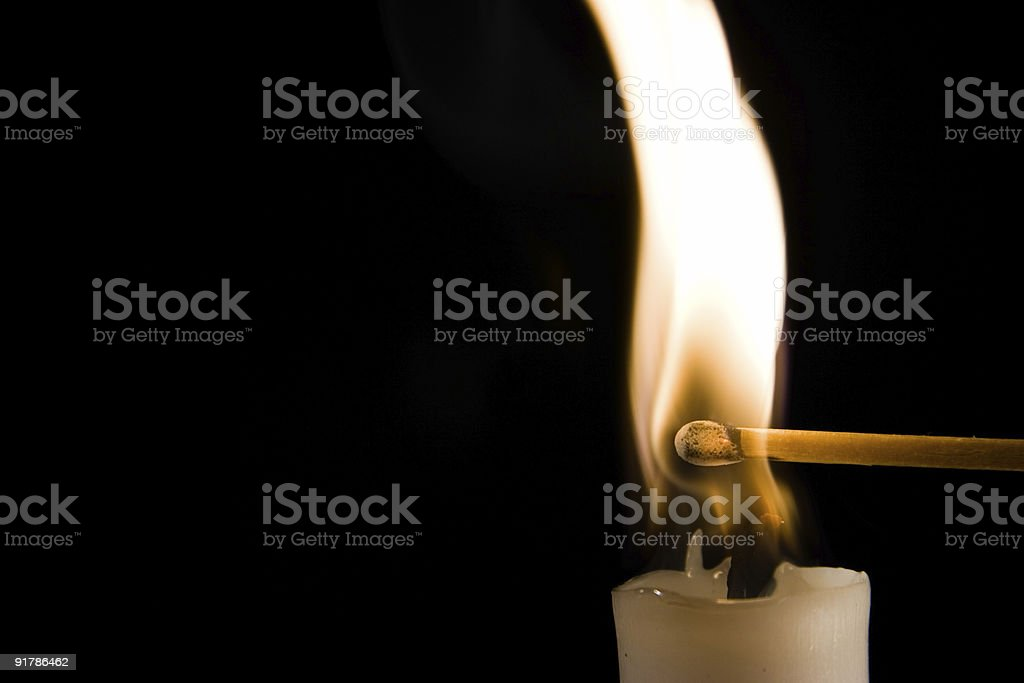 Burning Candle with Match royalty-free stock photo