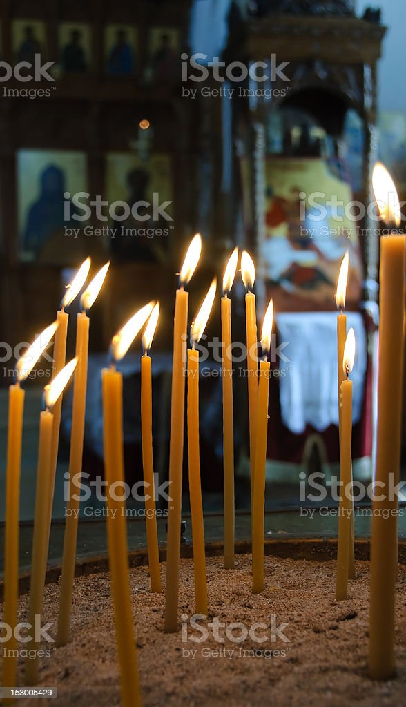 Burning candles in a  church royalty-free stock photo