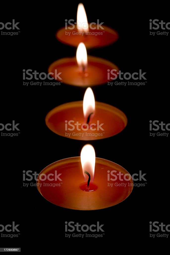 burning candles in a row royalty-free stock photo